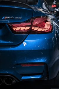 The back of a blue BMW M4.